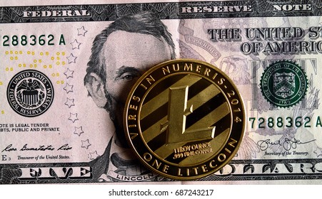 Litecoin on five  dollar banknote. cryptocurrency Trading concept