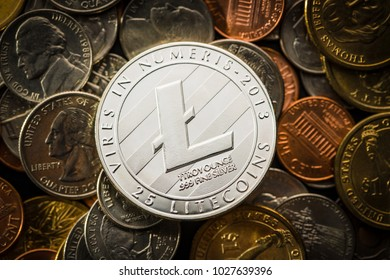 Litecoins. Digital cryptocurrency on american coins. Dollar coins.