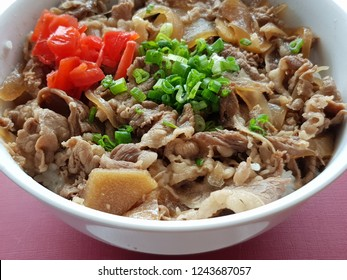 Gyūdon, literally beef bowl, is a Japanese dish consisting of a bowl of rice topped with beef and onion simmered in a mildly sweet sauce flavored with dashi, soy sauce and mirin