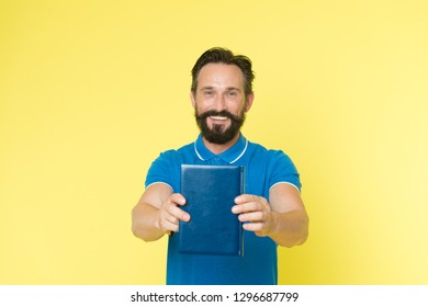 Literary critic. Man mature bearded guy hold book. Satisfied reader. Book presentation concept. Author presenting book copy space. Bestseller and book store. Literature taste and recommendations.