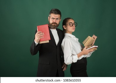 Literature lesson and reading grammar book. Education in knowledge day. School time of daughter and father in library. Teacher man and girl hold book pile at school. Back to school and home schooling.