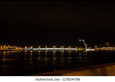 The Liteyny bridge after the opening. (Arsenalnaya and Kutuzov embankments). Night shooting from the corner of Petrovskaya Embankment in St. Petersburg