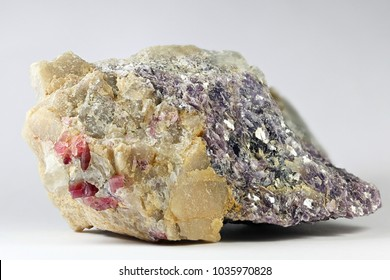 Lithium mica lepidolite, red lithiium tourmaline elbaite and brownish lithium mineral spodumene  from Haapaluoma lithium quarry in Finland.