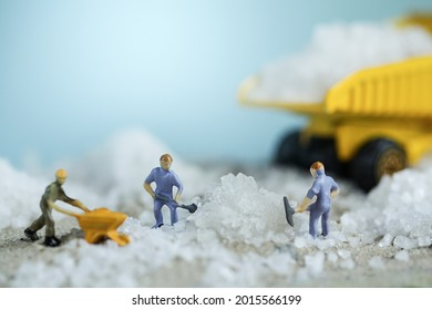 Lithium mining. Renewable energy concept. Miniature worker mining Lithium. Mining business or Department of Mineral Resources. Selective focus