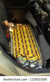 Lithium-ion batteries are connected to the electric circuit of an electric vehicle.
