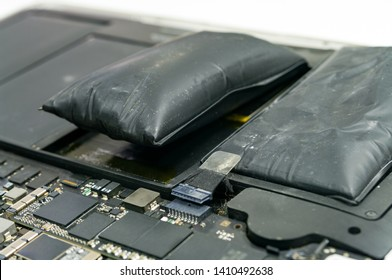 Lithium-ion battery on laptop, which has expanded.