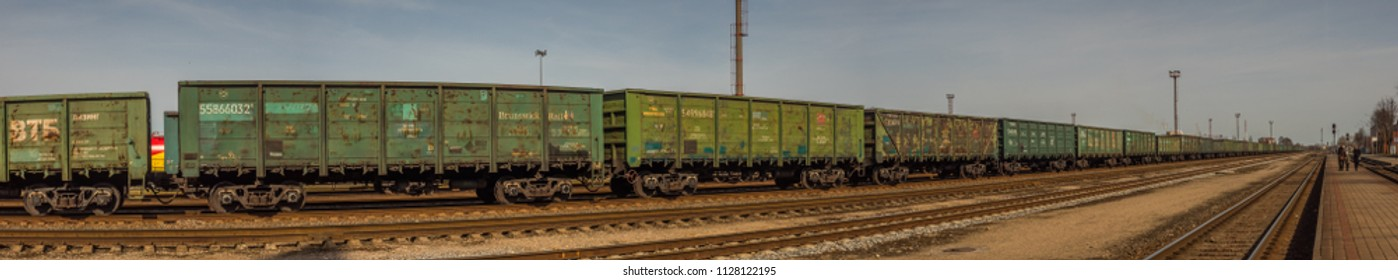 Kłajpeda, Lithuania - April 07, 2018: Various colorful wagons of a cargo train on the train station in Kłajpeda