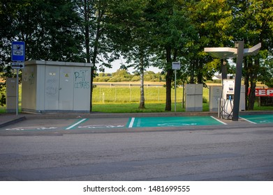LITHUANIA - AUG 11, 2019: ABB Power supply for electric car charging. Electric car charging station. ABB is a Swiss-Swedish corporation operating mainly in robotics, power, heavy electrical equipment.