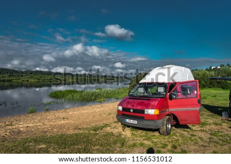 ffc1a4bbb5 LITHUANIA - August 2018  VW Transporter T4 on a small lake in Lithuania  with view