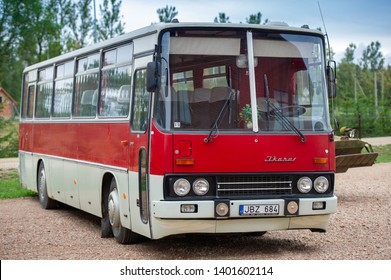 LITHUANIA - AUGUST 25, 2018: Red interurban bus Ikarus 250. The Ikarus 250 is a high-floor bus used as a coach for long-distance service. Ikarus was a bus manufacturer based in Hungary.
