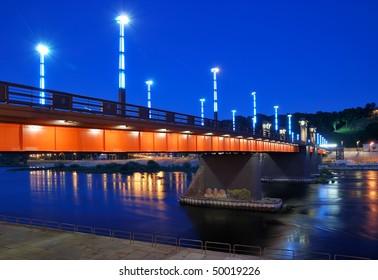 Lithuania. City of Kaunas. Illuminated bridge across Nemunas river at night