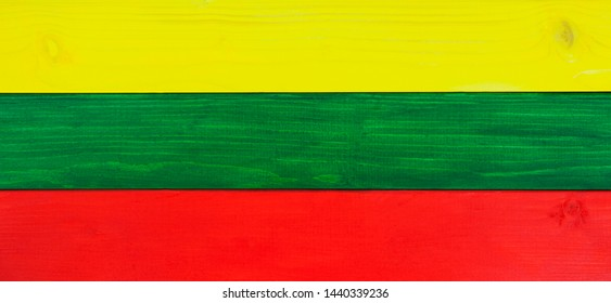 Lithuania flag in panorama / wide banner tricolors - in natural, wooden texture - background design for Lithuanian culture.