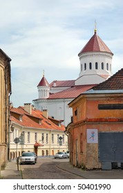 Lithuania. Historical center of the city of Vilnius. Old narrow paved street and The Orthodox Church of the Holy Mother of God.