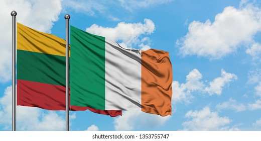 Lithuania and Ireland flag waving in the wind against white cloudy blue sky together. Diplomacy concept, international relations.