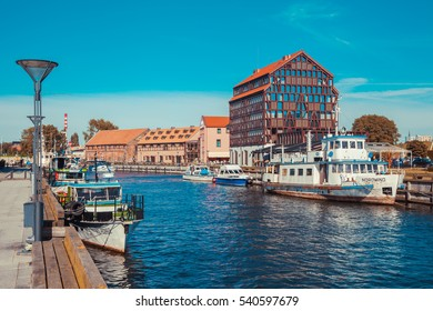 LITHUANIA, KLAIPEDA - JULY 20, 2016: Ships and boats on Dane river in oldtown  of Klaipeda. Lithuania.