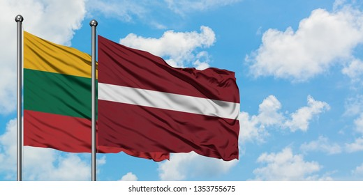 Lithuania and Latvia flag waving in the wind against white cloudy blue sky together. Diplomacy concept, international relations.