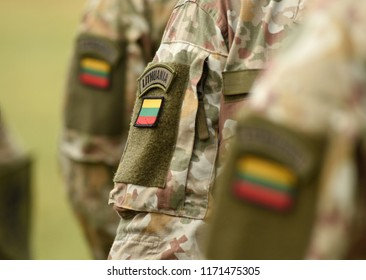 Lithuania patch flag on soldiers arm. Lithuanian military uniform. Lithuania troops