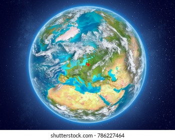 Lithuania in red on model of planet Earth with clouds and atmosphere in space. 3D illustration. Elements of this image furnished by NASA.