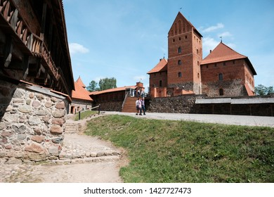 LITHUANIA, TRAKAI - 1 JUNE 2019: Summer view to Trakai medieval red brick castle of Lithuania with blue sky and clouds
