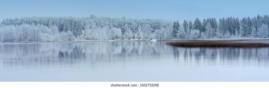 Lithuania winter panorama .Lake Bijote,Kurtuvenai regional park. Amazing reflections,nice view,light,place.