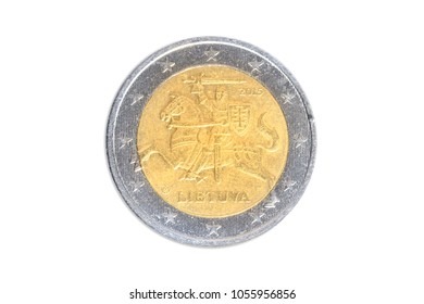 Lithuanian coin of two euro close-up with Lietuva horseman symbol of Lithuania. Isolated on white studio background. Head side.