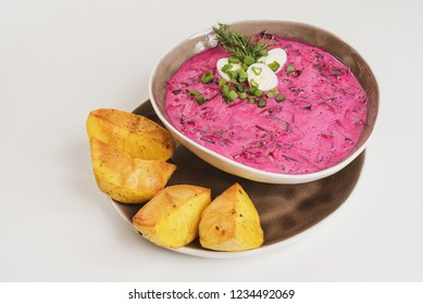 Lithuanian cold beet soup (Saltibarsciai) served with baked potatoes