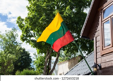 Lithuanian flag develops on the wall of the house