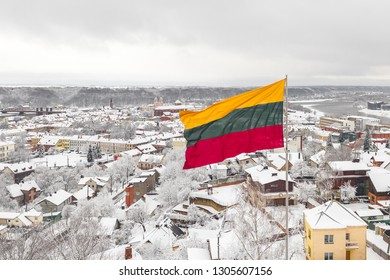 Lithuanian flag in the wind. Kaunas city in the background. Drone aerial view.