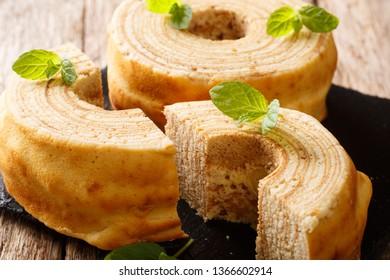 Lithuanian sakotis or raguolis, Polish sekacz is a traditional spit cake close-up on a wooden table. horizontal