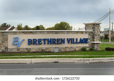 Lititz, Pennsylvania/United States - May 6 2020: Large new sign for the Brethren Village retirement community, at the Lititz Pike and Airport road intersection