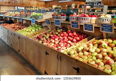 Lititz, Pennsylvania/United States - September 18 2018: A variety of apples and peaches in wooden display boxes, at a local farmers market in Lancaster County, Pennsylvania