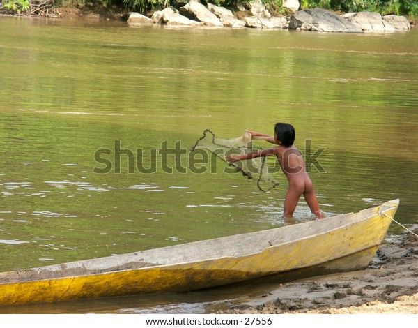 Litle Fishermen or Litle Worker and his net beside a boat