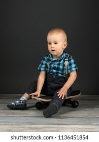 litlle boy with skateboard