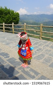 A litlle girl dressed in ancient Chinese Miao nationality clothing. Located in guilin,guangxi,china