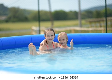 litlle sister in pool