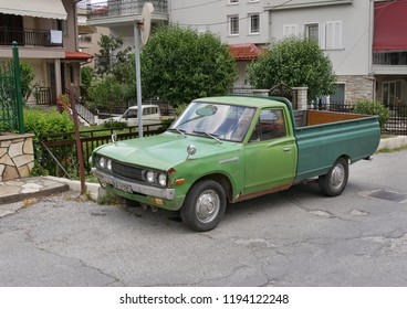 LITOCHORO, GREECE - JULY 24 2018,Old vintage green  pickup truck Datsun 1500 at street in Litochoro July  24. 2018. Olympus region, Macedonia, Greece