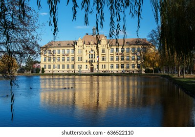 LITOVEL, CZECH REPUBLIC -NOVEMBER 14, 2015: The historic high school building built in 1901 in Litovel, in the mirror of pond by autumn