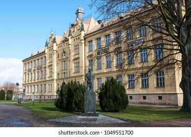 LITOVEL, CZECH REPUBLIC -NOVEMBER 19, 2017: The historic high school building built in 1901, the statue of the first president of the Czechoslovak Republic T. Masaryk in the foreground