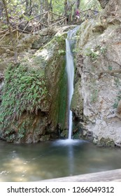 litte waterfall with a small lagoon in the valley of butterflies called Petaloudes at Rhodes in Greece