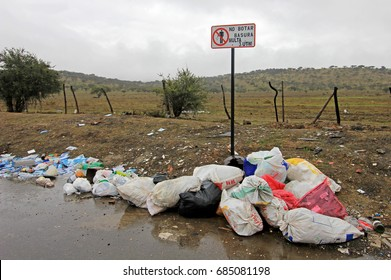 Littering of garbage in front of do not litter sign, Chile, South America