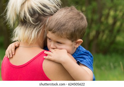 Little 3 years old boy in mother' s embracing/Child' s Sadness