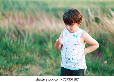 little 6 years boy discovered a bug which he found on field