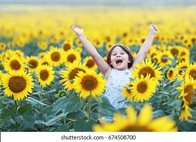 little 6 years old boy jumping on sunflower field
