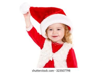 little adorable girl of 2 years on christmas isolated in white. studio shot. Lovely child in Santa hat, smiling. Christmas and new year.