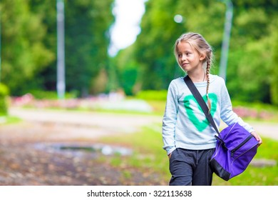 Little adorable girl going to the gym with her sports bag