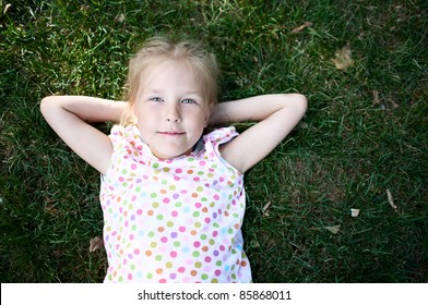 Little adorable girl  on the grass