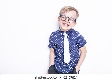 Little adorable kid in tie and glasses. School. Preschool. Fashion. Studio portrait isolated over white background