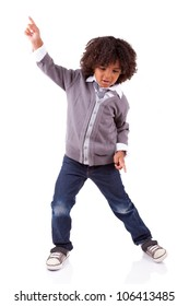 Little african american boy dancing,isolated on white background