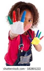 Little African Asian girl with hands painted in colorful paints