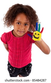 Little African Asian girl with painted hands in colorful paints